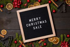 Merry Christmas sale letter board on dark rustic wood backgroun stock photo