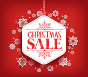 Merry Christmas Sale in Winter Snow Flakes Hanging Royalty Free Stock Photos