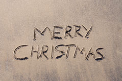 Merry Christmas in Sand Stock Images