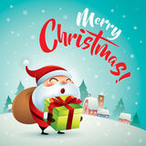 Merry Christmas! Santa Claus in Christmas snow scene. Christmas greeting card. Royalty Free Stock Photography
