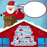 Merry christmas Santa Claus climbing in the. Chimney with sack of presents and with speech bubble for your text Royalty Free Stock Photos