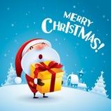 Merry Christmas! Santa Claus giving Christmas present. Royalty Free Stock Image