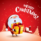 Merry Christmas! Santa Claus giving Christmas present. Royalty Free Stock Photos