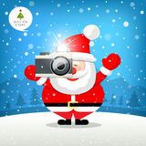 Merry christmas Santa claus hand holding photo camera Stock Photo