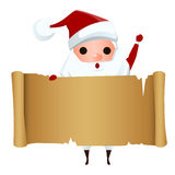 Merry Christmas. Santa Claus holding santa`s list old Paper. Stock Photography