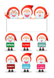 Merry Christmas. Santa Claus holding signs, open, closed, sorry, hiring Royalty Free Stock Photo