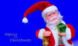 Merry christmas santa claus. Picture with a blue background Stock Photos