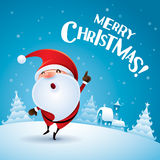 Merry Christmas! Santa Claus point finger up. Santa Claus pointing finger up in Christmas snow scene Stock Photo