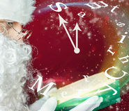 Merry Christmas with Santa Claus reading fairy tale Stock Image