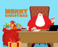 Merry Christmas. Santa Claus at work. Big red bag with gifts for Stock Photos