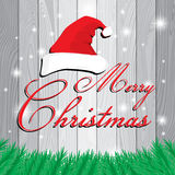Merry Christmas and Santa`s cap on white and grey wooden background. Christmas tree on grey Lath boards background. Royalty Free Stock Photos