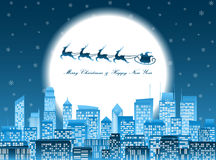 Merry christmas santa in a sledge flying over a night city Royalty Free Stock Image