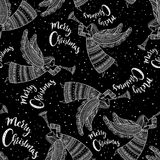 Merry Christmas seamless pattern with angel black. Merry Christmas seamless pattern with angel with horn and snow in night sky with stars. Can be printed and Stock Images