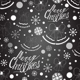 Merry Christmas seamless pattern on the black chalk board Royalty Free Stock Photography
