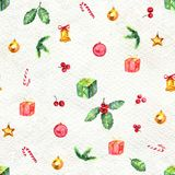 Merry Christmas seamless pattern. Watercolor Illustration with holly berry, candy cane, balls, gifts and gold bells  on white background Royalty Free Stock Image