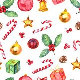 Merry Christmas seamless pattern. Watercolor Illustration with holly berry, candy cane, balls, gifts and gold bells isolated on white background Stock Photos