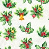 Merry Christmas seamless pattern. Watercolor Illustration with holly berry, candy cane, balls, gifts and gold bells isolated on white background Royalty Free Stock Images