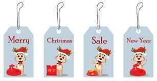 Merry Christmas. Set of hang tags with cute dog wearing Santa Cl Royalty Free Stock Photo