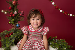 Merry Christmas Setup: Girl in Red and White Dress Royalty Free Stock Photo