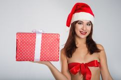 Merry Christmas with sexy woman in santa red hat Stock Photo