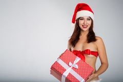 Merry Christmas with sexy woman in santa red hat Stock Photography