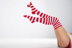 Merry Christmas with sexy woman in santa red hat Royalty Free Stock Photos