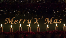 Merry Christmas sign with candle and light Royalty Free Stock Photos
