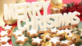 Merry Christmas sign with cinnamon cookies Stock Photos