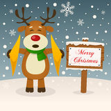 Merry Christmas Sign with a Cute Reindeer royalty free illustration