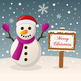 Merry Christmas Sign with a Cute Snowman royalty free stock photos