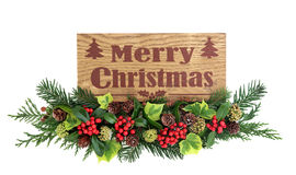 Merry Christmas Sign and Flora Decoration Royalty Free Stock Photography