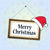 Merry Christmas sign in the frame with santa`s hat Royalty Free Stock Photo
