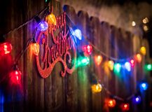 Merry Christmas sign and lights stock photos