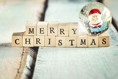 Merry Christmas sign made of wooden letters. Royalty Free Stock Photos