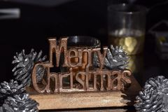 Merry Christmas sign in metal. Chrome bronze gold brass bronze Xmas season seasonal holiday festive winter dark background wishes greeting royalty free stock photography