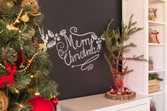 Merry christmas sign. N a blackboard above commode with decorations stock photography