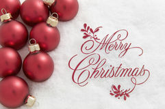 Merry Christmas Sign and Ornaments in Snow Stock Photo