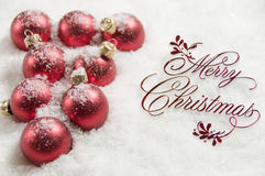 Merry Christmas Sign and Ornaments in Snow Stock Images