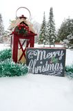 Merry Christmas Sign in Snow. A Merry Christmas sign outside in the snow with pine trees in the background royalty free stock images