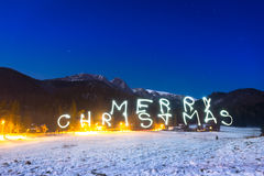 Merry Christmas sign under Tatra mountains at night Stock Image