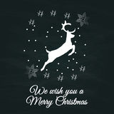 Merry Christmas sign vintage sketch style with deer at grunge chalkboard Stock Photos