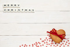 Merry Christmas sign on wood with sweets Stock Photos
