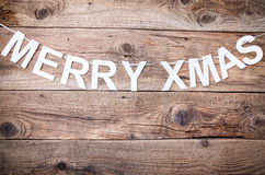 Merry Christmas sign on wooden background Stock Image