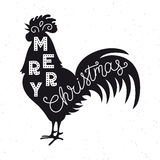 Merry Christmas. Silhouette hand lettering. Chinese calendar symbol of 2017 year. Rooster, cock. Holiday design, art print. For posters, greeting cards design Royalty Free Stock Image