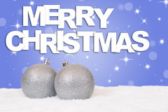Merry Christmas silver balls decoration with snow Stock Photo