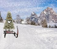 Merry christmas a smiling happy christmas pine tree sleighing down the ski hill slope on a sleigh in snowy weather in a winter stock photo