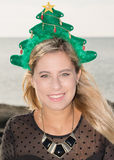 Merry Christmas. A smiling young woman with a Christmas hat Royalty Free Stock Photos