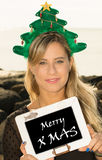 Merry Christmas. A smiling young woman with a Christmas hat and the message Merry XMas Royalty Free Stock Image