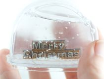Merry Christmas in snow globe Stock Photography