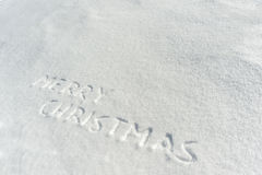 Merry Christmas on snow Stock Photo